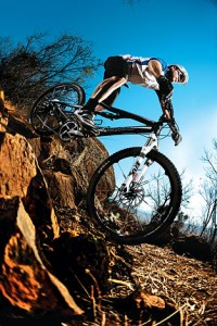 Action image of a cyclist for Tread Magazine shot with a tamron lens singer photographic workshop, sandton, northern suburbs, bryanston, johannesburg, fourways by ben bergh of ben bergh photography